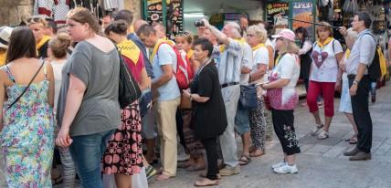 Via Dolorosa pilgrims with selfie gear