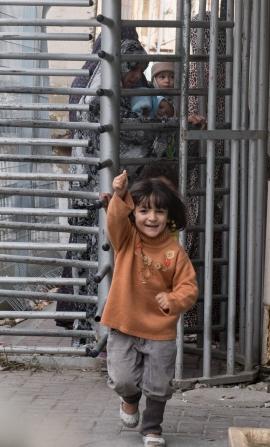 27-10-15 Hebron Schoolgirl happy to be through the turnstile of CP56 EAPPI BGSaltnes